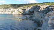 Acantilados de La Mola a la derecha de Punta de s'Anfossol